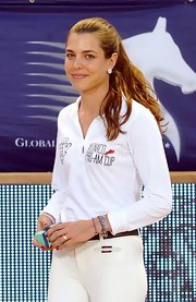 Charlotte Casiraghi accessorized with some beaded bracelets while competing at the Pro Am Jumping event.
