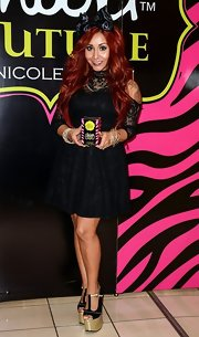 Nicole Polizzi got major height enhancement thanks to those towering black and gold T-strap platform sandals.