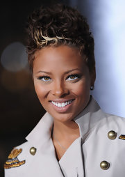 Eva Pigford hit the premiere of 'Law Abiding Citizen' rocking a sky-high curly fauxhawk.