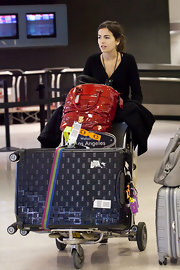 Camilla Belle sure doesn't travel light! Along with her rollerboard, she was carrying an oversized red patent tote.