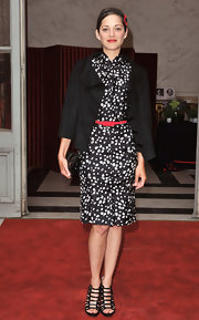 Mation Cotillard styled her dress with a vintage-chic swing jacket.