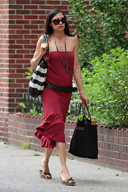 Famke Janssen paired her summer dress with a pair of wedge slip-ons.