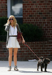 For her footwear, Sienna Miller kept it comfy in monochrome gladiator sandals by Sigerson Morrison.