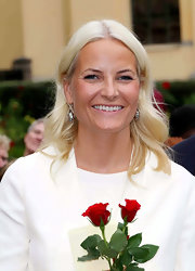 Princess Mette-Marit wore her hair down in a center-parted wavy style during her 10th wedding anniversary celebration.