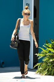 Miley Cyrus completed her laid-back getup with a pair of cheeky flip flops.