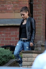 Mila Kunis rocked a leather jacket and distressed jeans combo while grabbing dinner.