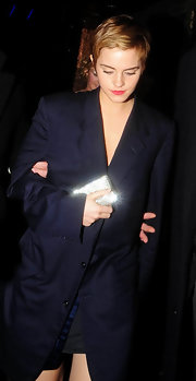 Emma Watson was spotted out and about holding a dazzling Swarovski crystal-studded clutch by Anya Hindmarch.