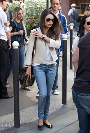 For her arm candy, Mila Kunis chose a bronze leather shoulder bag by Loewe.