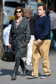 Linda Evangelista spent time with a friend wearing a plaid top, skinny jeans, and a trenchcoat to top it.