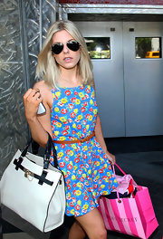 Mollie King hid her eyes behind a pair of Ray-Ban aviators while shopping at the Beverly Center.