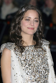 Marion Cotillard clipped her bangs back with a silver hair pin for a youthful look during the BAFTAs.