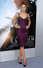Stana Katic flaunted her svelte figure in a plum and black corset dress by Bec & Bridge at the premiere of 'Elysium.'