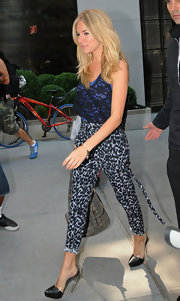 Sienna Miller worked a wild print with a pair of leopard pants.
