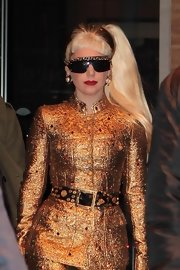 Lady Gaga paired a studded Chanel belt with a perfectly tailored gold suit for a New Year's Eve celebration.