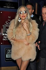 Lady Gaga teamed a Rodrigo Otazu silver bracelet with a beige fur coat for a night out.