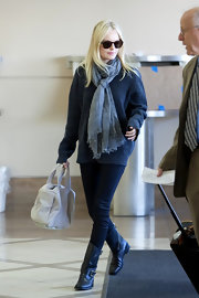 Kate Bosworth made her way through LAX holding a chic Alexander Wang Rocco stud-bottom duffel.