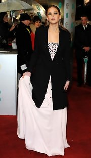 Jennifer Lawrence arrived at the BAFTA Awards wearing a black wool coat over her gown.