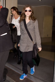 Anna Kendrick was spotted at LAX wearing bright blue Asics crosstrainers.