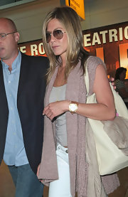 Jennifer Aniston accessorized with a stylish leather-band chronograph watch during a flight to London.