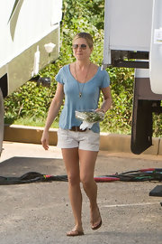 Jennifer Aniston teamed her tee with white short shorts.