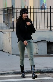 Padma Lakshmi added a dose of shine with a pair of black patent boots.