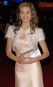 A jewel-trimmed white velvet clutch finished off Emmy Rossum's look in ultra-glam style.