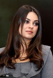 Mila Kunis looked sweet wearing this long hairstyle with wavy ends at the 'Oz the Great and Powerful' photocall in Moscow.