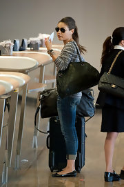 Mila Kunis was spotted at LAX carrying a quilted black leather bag by Chanel.