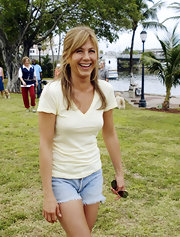 Jennifer Aniston completed her laid-back look with frayed jean shorts.