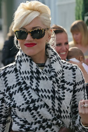Gwen Stefani attended a baby shower looking retro-glam with her updo and tortoiseshell sunnies.