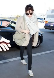Emma Watson caught a flight out of LAX wearing a nude Tophsop boyfriend blazer.