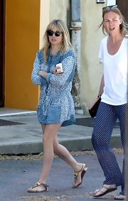 Sienna Miller teamed her romper with a pair of tribal-patterned thong sandals.