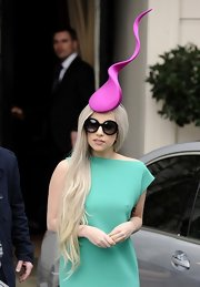 Lady Gaga's purple Philip Treacy fascinator and green dress were a gorgeous color combo!