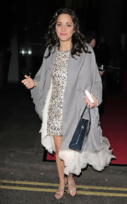 Marion Cotillard left the BAFTAs wearing a gray shawl over her Chanel Couture dress.