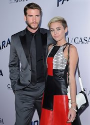 Miley Cyrus attended the premiere of 'Paranoia' carrying a chic Chanel Boy bag, in white with black trim.