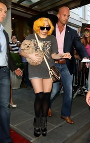 Lady Gaga punched up her look with a pair of knee-high socks and studded boots.