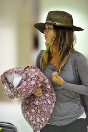 Rachel Bilson looked adorable at LAX wearing a shell-embellished straw hat and carrying a pillow.