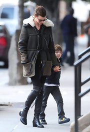 Linda Evangelista was spotted out with her son wearing a winter ensemble featuring a pair of over-the-knee boots.