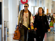 Ryan Gosling casually carried a handsome camel duffle as he walked through LAX.