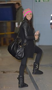 For her bag, Michelle Keegan chose a stylish leather hobo bag.