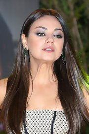 Mila Kunis glammed up her lobes with a pair of Gemfields Zambian emerald earrings by Dominic Jones.