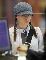 Anna Kendrick looked oh-so-cute wearing her hair in pigtail braids, complete with a gray tweed equestrian cap, while traveling to YVR.