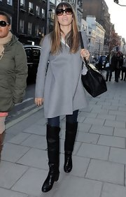 Jessica Biel went shopping in London rocking a pair of black over-the-knee boots.