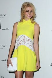 Pixie Lott brought some brightness to the Shard launch party with this white envelope clutch and neon-yellow dress combo.