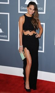 Chrissy Teigen opted for a glamorous black crop-top by Joy Cioci when she attended the Grammys.