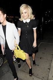 Pixie Lott brightened up her outfit with a yellow Miu Miu Nappa leather bag.