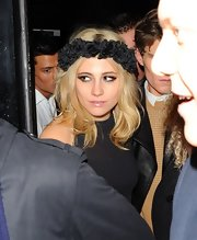 For her birthday party, Pixie Lott accessorized with a black floral headband from her collaboration with Rock 'N Rose.