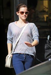 Emma Watson visited the Chanel store looking laid-back in a gray V-neck sweater and jeans.