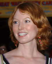 Alicia Witt sported a '70s-inspired 'do at the premiere of 'Pirates of the Caribbean: Dead Man's Chest.'