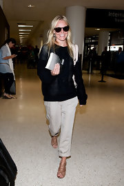 Kate Bosworth went for a super laid-back travel look with a pair of rolled-up slacks teamed with a cable-knit sweater.